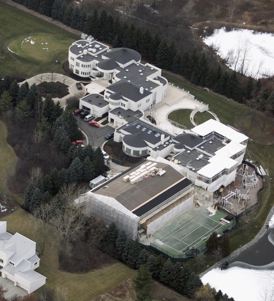 FILE - This Jan. 8, 2002 aerial file photo shows the home of former Chicago Bulls star Michael Jordan, in Highland Park, Ill. Jordan's 56,000-square foot home in suburban Chicago is up for auction. Concierge Auctions says the sale will take place Monday, Dec. 16, 2013. The company runs the sales of high-end real estate and features Jordan's Highland Park home north of Chicago on its website.  (AP Photo/Ted S. Warren, File)