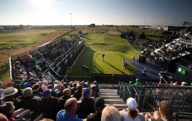 England's Richard Bland hits the opening shot in the 149th Open Championship at Royal St George's