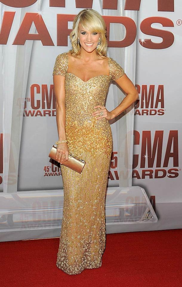 As expected, Carrie Underwood sparkled on the red carpet. The country cutie, who has hosted the CMAs alongside Brad Paisley for the past four years, looked stunning in a bedazzled gown and golden locks. You know this was just the first of many costume changes throughout the night for Carrie! (11/9/2011)