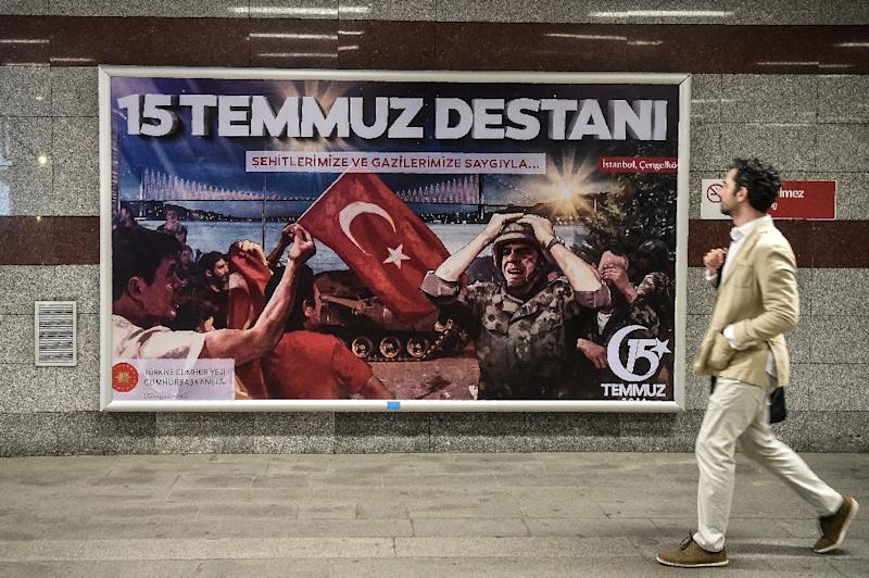 """Giant posters bearing the slogan """"Legend of July 15"""" have been plastered across  billboards in Istanbul to mark the anniversary of  last year's failed coup"""