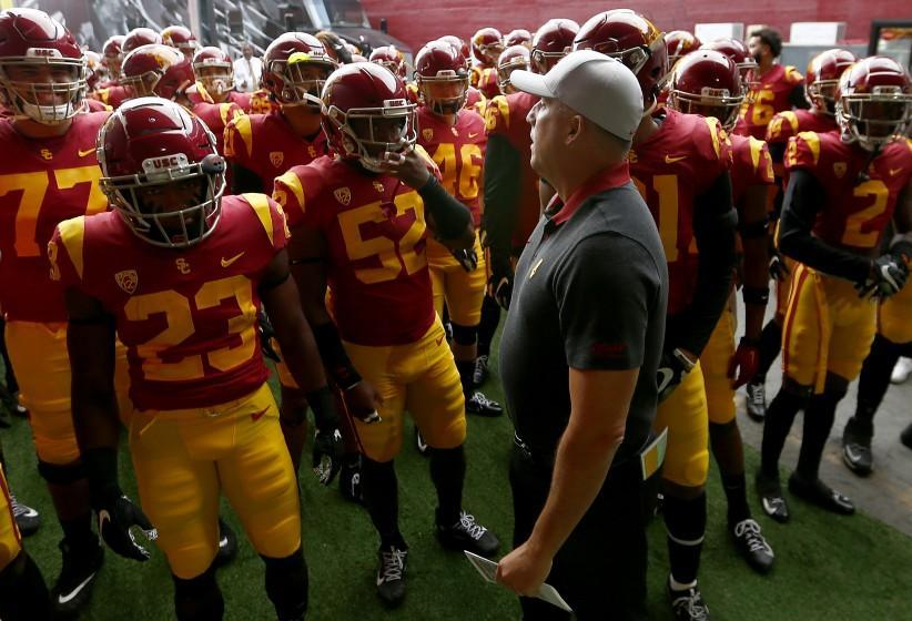 LOS ANGELES, CALIF. - OCT. 19, 2019. USC head coach Clay Helton leads his Trojans football squad.