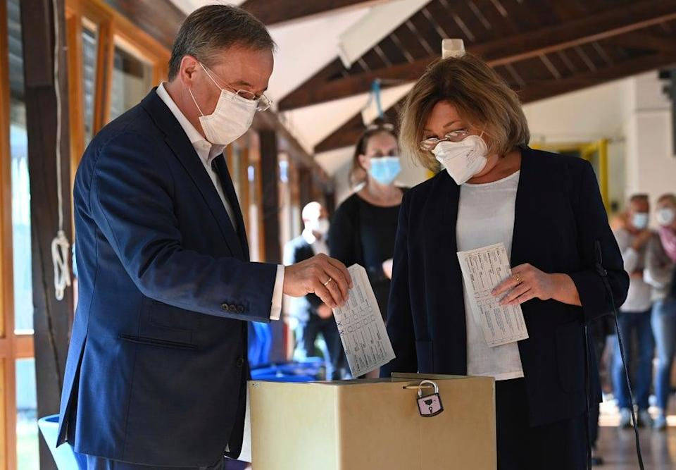 Candidate for chancellor Armin Laschet,  left, and his wife Susanne cast their ballots in Aachen on Sunday (AP)