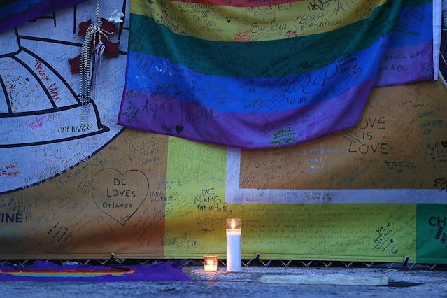 <p>A candle is displayed in the memorial set up outside the Pulse gay nightclub in memory of the victims of a mass shooting at the club one year ago on June 12, 2017 in Orlando, Florida. (Joe Raedle/Getty Images) </p>
