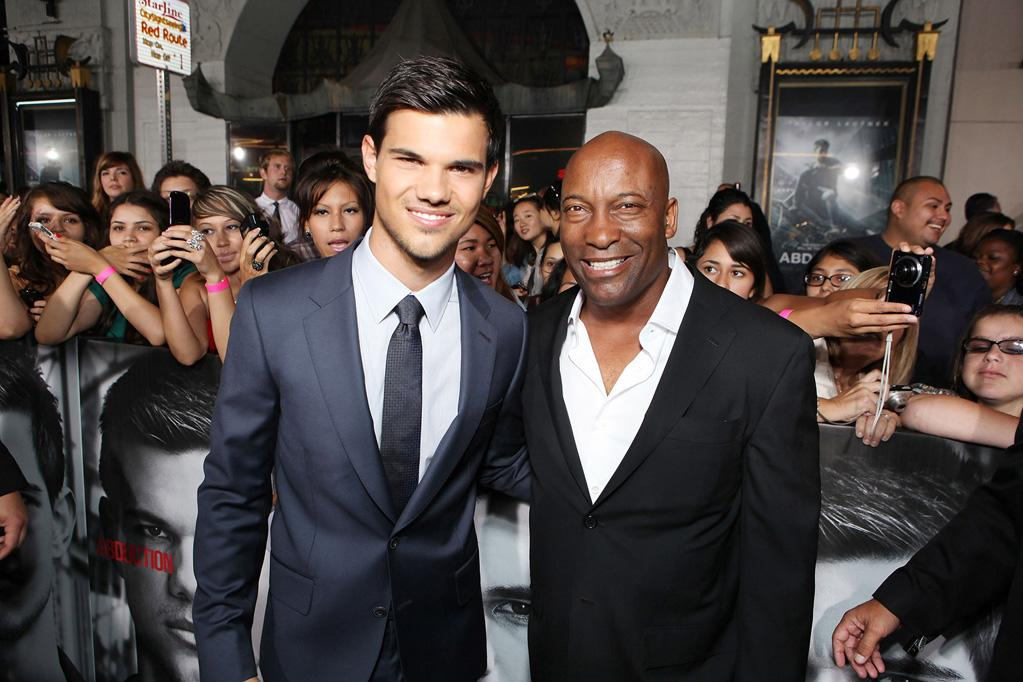 "<a href=""http://movies.yahoo.com/movie/contributor/1808598632"">Taylor Lautner</a> and <a href=""http://movies.yahoo.com/movie/contributor/1800024265"">John Singleton</a> at the Los Angeles premiere of <a href=""http://movies.yahoo.com/movie/1810180299/info"">Abduction</a> on September 15, 2011."