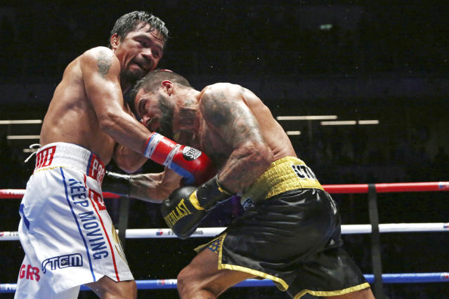 Manny Pacquiao (left) has also been rumored as an eventual opponent for Mikey Garcia, but his entourage and promotional dispute would stand in the way. (AP Photo/Yam G-Jun)