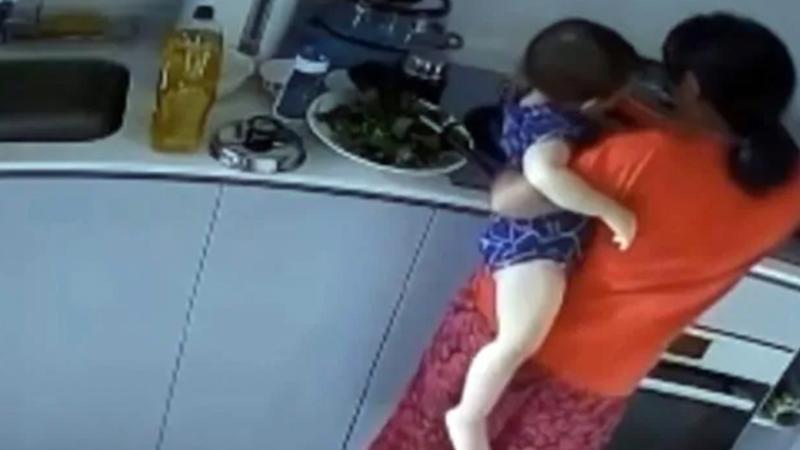 A housekeeper has been accused of putting a toddler's arm in boiling water in Singapore.