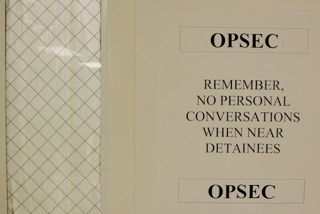 GUANTANAMO BAY, CUBA - MAY 09: (IMAGE REVIEWED BY U.S. MILITARY PRIOR TO TRANSMISSION) A sign reminds workers not to talk around detainee's is posted on a door in the hospital for detainee's at Camp Delta May 9, 2006 in Guantanamo Bay, Cuba. Camp Delta was first occupied on April 28, 2002, when 300 detainees previously held at Camp X-Ray were transferred to Camp Delta. The rest of the detainees were moved on April 29. Camp X-Ray closed down on that same day. (Photo by Mark Wilson/Getty Images)
