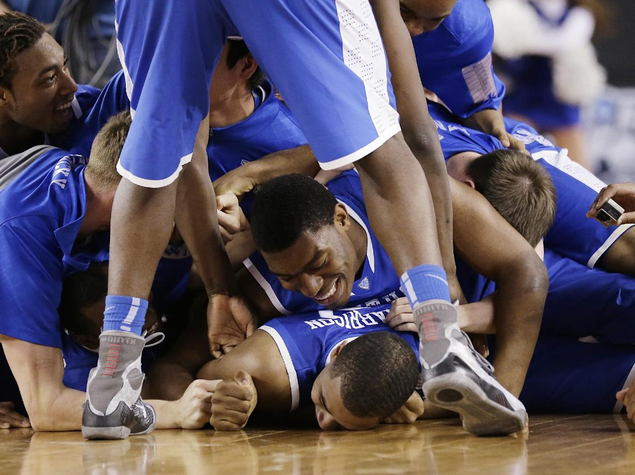 Kentucky players celebrate on the court after their 74-73 victory over Wisconsin in an NCAA Final Four tournament college basketball semifinal game Saturday, April 5, 2014, in Arlington, Texas.(AP Photo/Eric Gay)