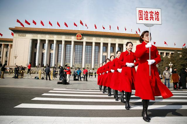 <p>Ushers walk outside the Great Hall of the People during the opening session of the National People's Congress (NPC) in Beijing on March 5, 2018. (Photo: Thomas Peter/Reuters) </p>