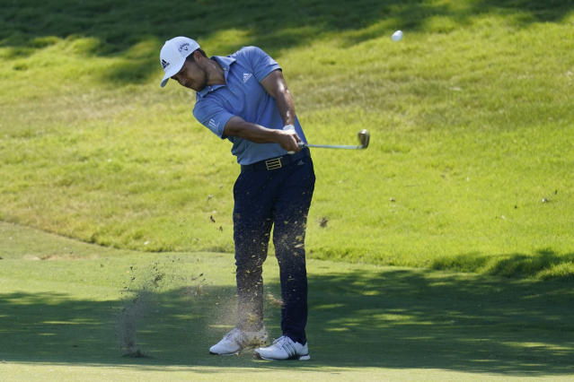 Xander Schauffele hits his second shot on the 18th fairway during the third round of the Charles Schwab Challenge golf tournament at the Colonial Country Club in Fort Worth, Texas, Saturday, June 13, 2020. (AP Photo/David J. Phillip)
