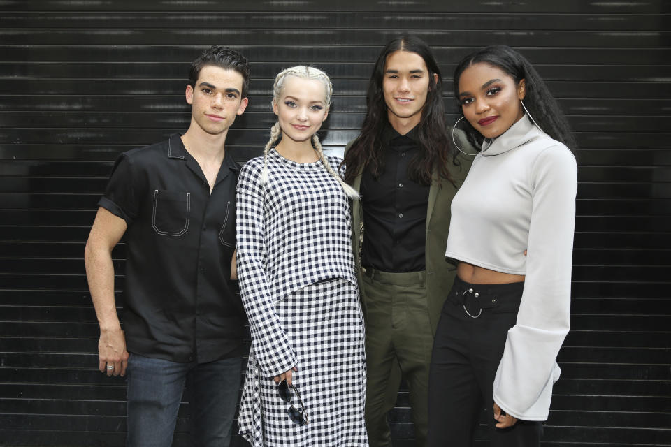 """IMAGE DISTRIBUTED FOR DISNEY ABC - Actor Cameron Boyce, Dove Cameron, Booboo Stewart, and China Anne McClain seen outside of the Disney Channel's """"Descendants 2"""" panel event at the Soho Apple Store on Monday, July 17, 2017 in New York. (Mark Von Holden/AP Images for Disney ABC)"""
