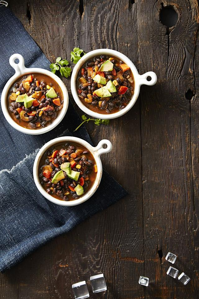 """<p>The perfect thing to cozy up with tonight is this hearty but healthy dish, loaded with tons of carrots, corn, celery, onions, and black beans. </p><p><em><a rel=""""nofollow"""" href=""""http://www.goodhousekeeping.com/food-recipes/healthy/a42397/smoky-vegan-black-bean-soup-recipe/"""">Get the recipe for Smoky Vegan Black Bean Soup »</a></em></p>"""