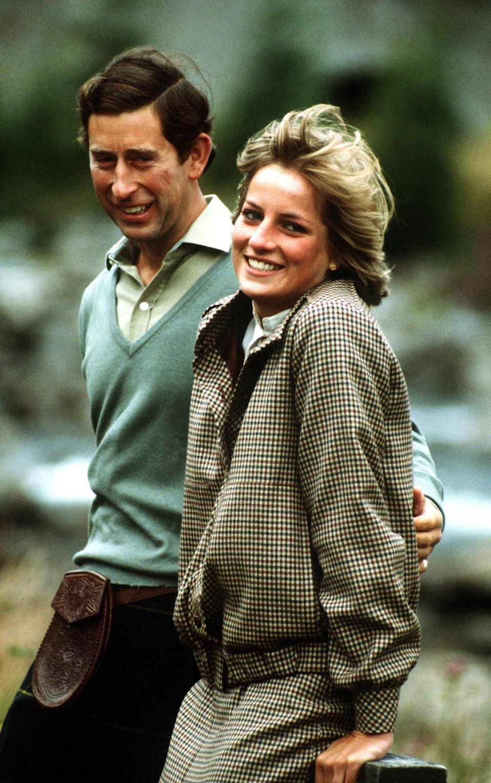 The Prince and Princess of Wales stand by the River Dee on the Balmoral estate during their honeymoon in Scotland, September 1981. The Princess wears a suit by Bill Pashley. (Photo by Jayne Fincher/Princess Diana Archive/Getty Images)