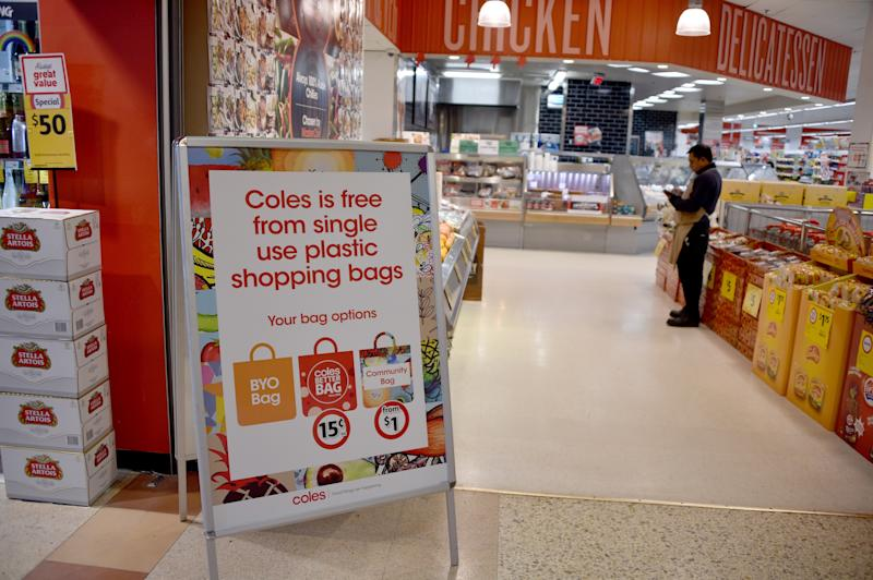 A sign, seen in a Coles supermarket, advises its customers of its plastic bag free in Sydney on July 2, 2018.
