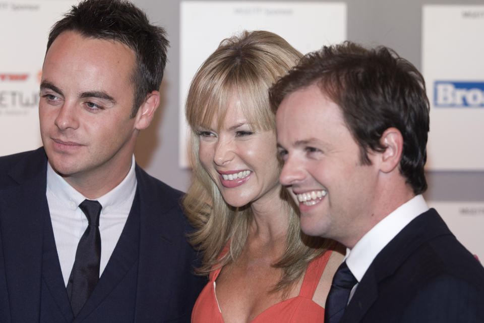 Television star Amanda Holden appears at a photo call with fellow celebrities Ant and Dec (Anthony McPartlin and Decland Donnelly) at the start of the Edinburgh International Television Festival. The annual festival was staged at the city's conference center and attracted media personalities from across the industry. (Photo by Colin McPherson/Corbis via Getty Images)