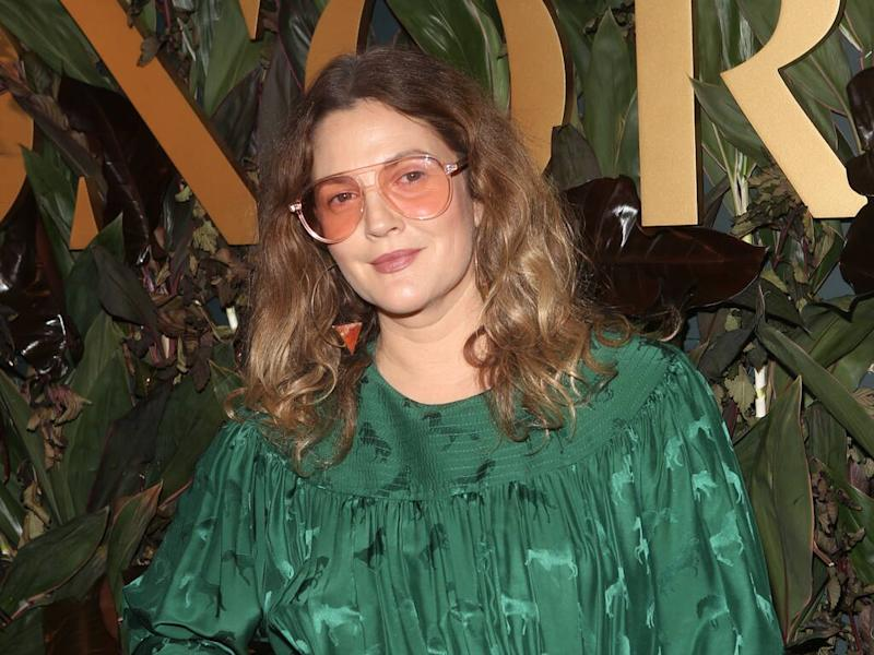 Drew Barrymore cleans her house wearing lotion-infused gloves