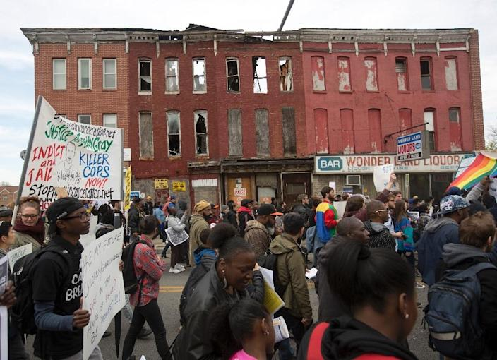 Protesters march during a rally in Baltimore, Maryland, on April 25, 2015, against the death of Freddie Gray while in police custody (AFP Photo/Andrew Caballero-Reynolds)