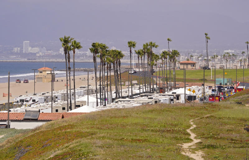 An RV park at Dockweiler State Beach is seen where some coronavirus patients are being quarantined, Friday, April 3, 2020, in Los Angeles. The new coronavirus causes mild or moderate symptoms for most people, but for some, especially older adults and people with existing health problems, it can cause more severe illness or death. (AP Photo/Mark J. Terrill)
