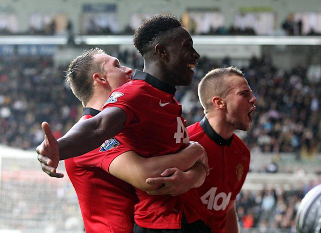 Manchester United's Danny Welbeck (centre) celebrates scoring his sides fourth goal of the game