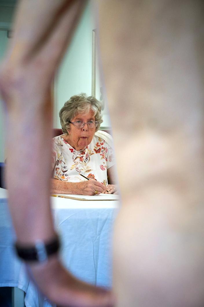 Care home residents made pencil sketches of a nude model. [Photo: Simon Jacobs]