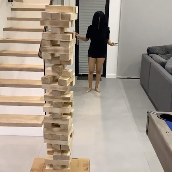 Cardi B created a giant game of Jenga in her home.