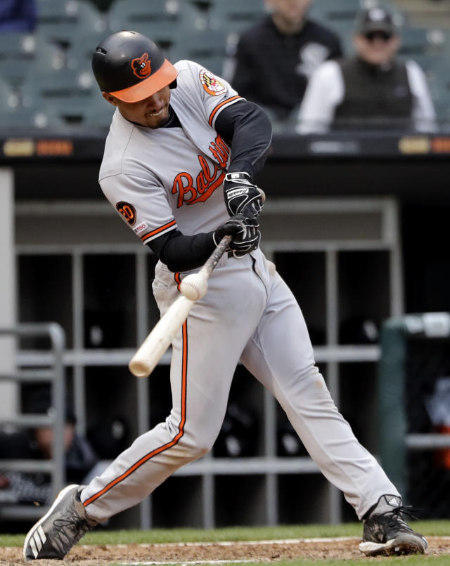 Baltimore Orioles' Richie Martin hits a triple against the Chicago White Sox during the eighth inning of the first game of a baseball doubleheader in Chicago, Wednesday, May 1, 2019. (AP Photo/Nam Y. Huh)