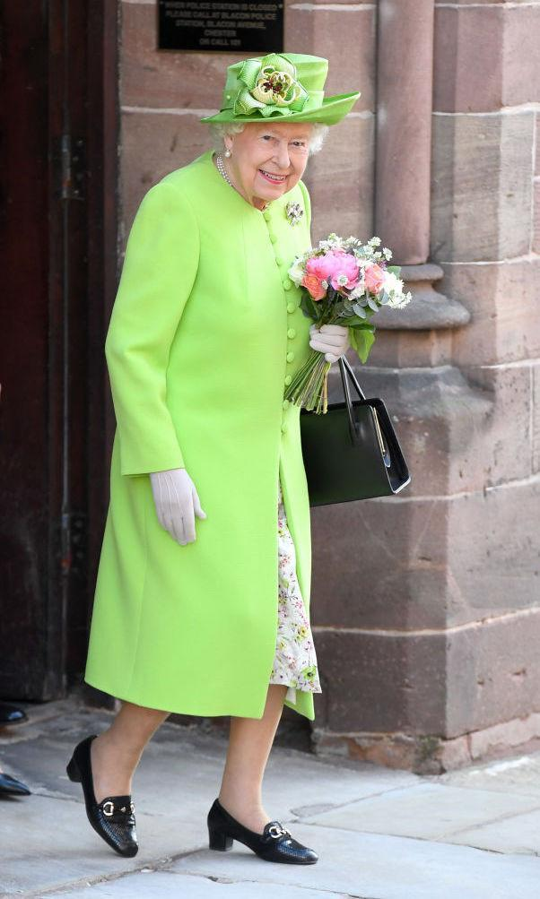 <p>For the Duchess of Sussex's first solo engagement with the Queen, the regal duo headed to Chester for a day of unveiling plaques and shaking hands with the public. Not one to be upstaged, Her Majesty wore a vibrant lime-hued coat and summer florals. <em>[Photo: Getty]</em> </p>