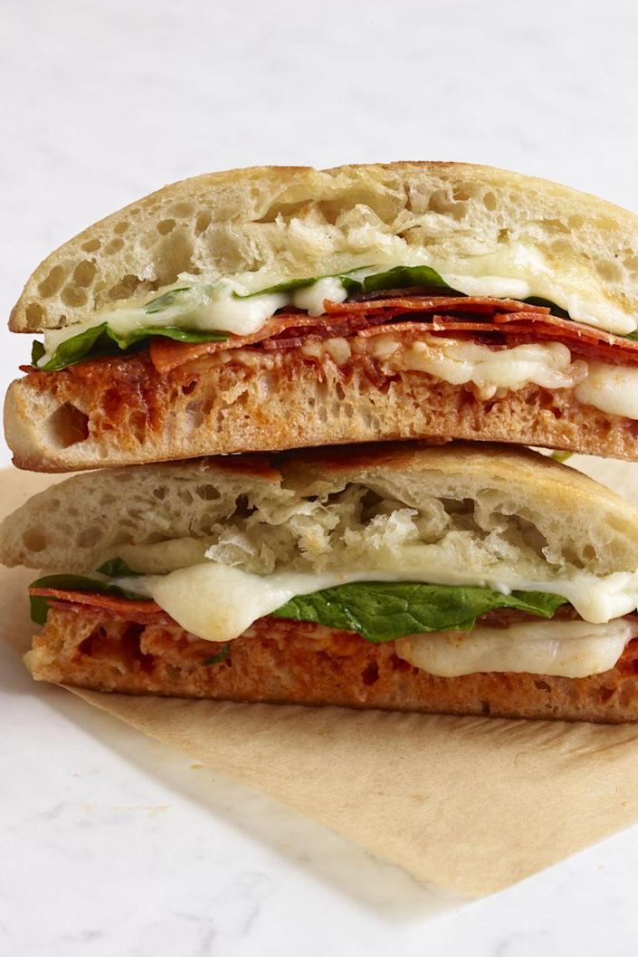 """<p>This Italian-inspired sandwich has all the makings of a great bite: Greens, salty cured meat, and rich cheese. Yum. </p><p><a href=""""https://www.womansday.com/food-recipes/food-drinks/recipes/a12127/pepperoni-spinach-mozzarella-grilled-cheese-recipe-wdy1013/"""" rel=""""nofollow noopener"""" target=""""_blank"""" data-ylk=""""slk:Get the recipe for Pepperoni, Spinach, and Mozzarella Grilled Cheese."""" class=""""link rapid-noclick-resp""""><em><strong>Get the recipe for Pepperoni, Spinach, and Mozzarella Grilled Cheese.</strong></em></a></p>"""