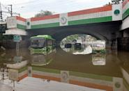 A DTC bus and other vehicles seen submerged after heavy rain and waterlogging under the Minto Bridge, on July 19, 2020 in New Delhi, India. Moderate-to-heavy rain lashed several states in northern, eastern and coastal India on Sunday, but the monsoon activity continued to remain subdued in Delhi, which has recorded a 40 per cent rainfall deficiency despite an early onset of the seasonal weather system. (Photo By Arvind Yadav/Hindustan Times via Getty Images)