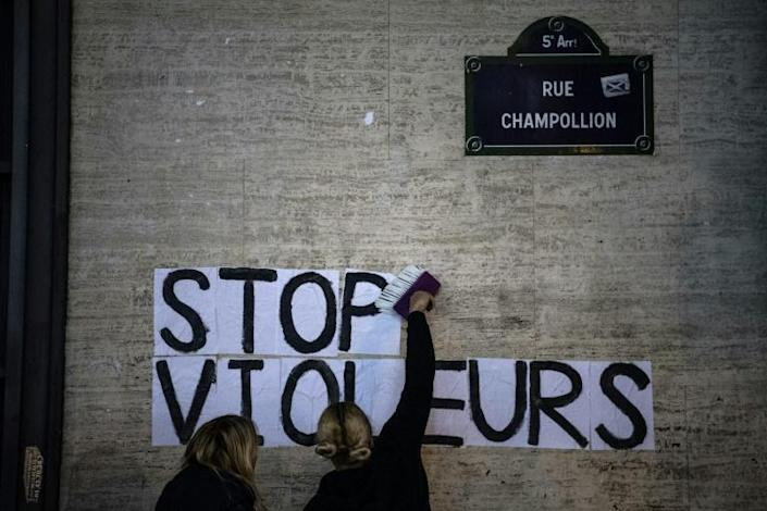 """""""Stop rapists"""": Demonstrators stuck a slogan on a wall in Paris close to where Roman Polanski's new film was showing (AFP Photo/Christophe ARCHAMBAULT)"""