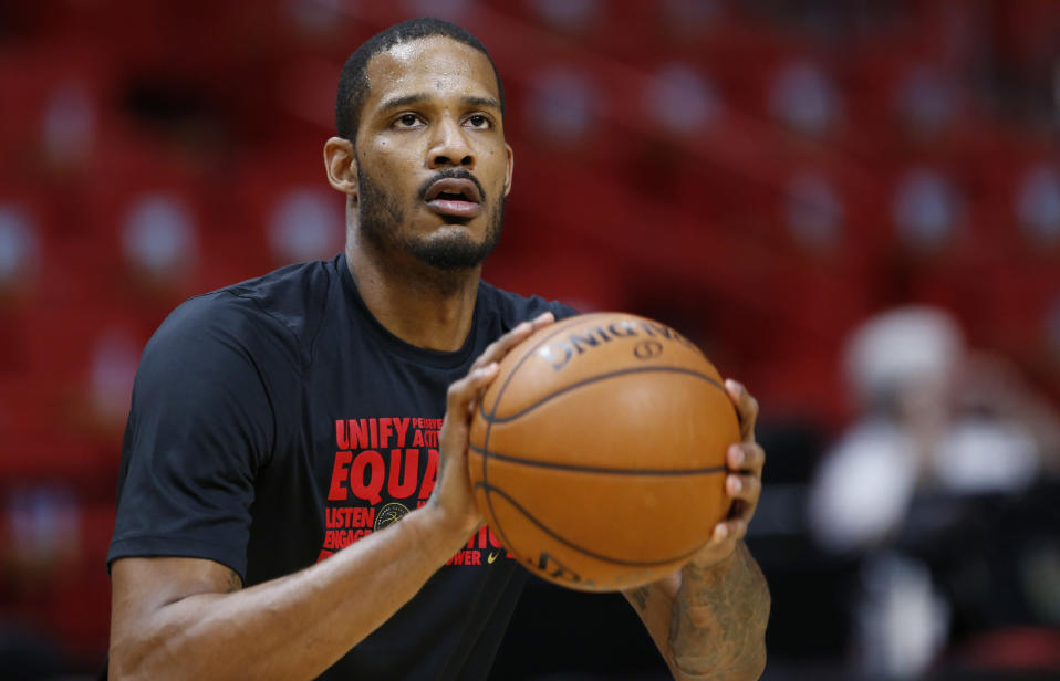 FILE - Houston Rockets forward Trevor Ariza warms up before the start of an NBA basketball game against the Miami Heat in Miami, in this Wednesday, Feb. 7, 2018, file photo. Ariza has had interest in playing for the Miami Heat since a draft workout in 2004. He was traded to Miami this week and now gets that long-awaited chance.(AP Photo/Wilfredo Lee, File)