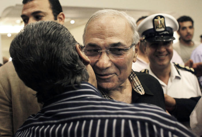 FILE - In this Friday, June 8, 2012 file photo, Egyptian presidential runoff candidate Ahmed Shafiq is greeted by a supporter after attending a press conference in Cairo, Egypt. Shafiq's candidacy has dismayed many Egyptians who believe the veteran figure of Mubarak's regime will only preserve the authoritarianism of his rule. But even if some Christians share those reservations, they view his opponent in the race as far worse: Mohammed Morsi, of the Muslim Brotherhood, which Egypt's Christian minority fears will turn the country into an Islamic state. (AP Photo/Nasser Nasser, File)
