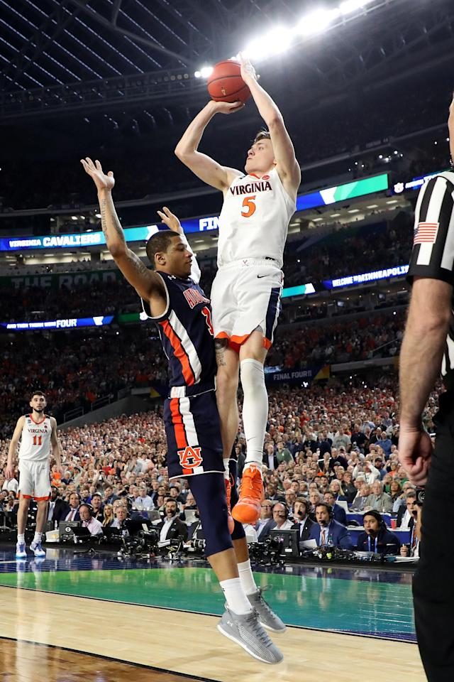 Kyle Guy #5 of the Virginia Cavaliers attempts a game-winning three point basket as he is fouled by Samir Doughty #10 of the Auburn Tigers in the second half during the 2019 NCAA Final Four semifinal at U.S. Bank Stadium on April 6, 2019 in Minneapolis, Minnesota. (Photo by Streeter Lecka/Getty Images)