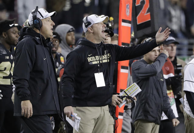 Purdue coach Jeff Brohm, center, yells from the sideline during the second half of the team's Foster Farms Bowl NCAA college football game against Arizona on Wednesday, Dec. 27, 2017, in Santa Clara, Calif. (AP Photo/Marcio Jose Sanchez)