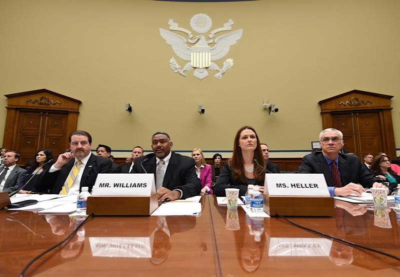 Witnesses listen to opening remarks before testifying before the House Oversight and Government Reform full committee hearing, Wednesday, May 7, 2014, in Washington. Shown from left are Patrick Sullivan, Assistant Inspector General for Investigations, Office of Inspector General, EPA, Allan Williams, Deputy Assistant Inspector General for Investigations, Office of Inspector General, EPA, Elisabeth Heller Drake, Special Agent, Office of Investigations, Office of Inspector General, EPA and Bob Perciasepe, Deputy Administrator, EPA. (AP Photo/Molly Riley)