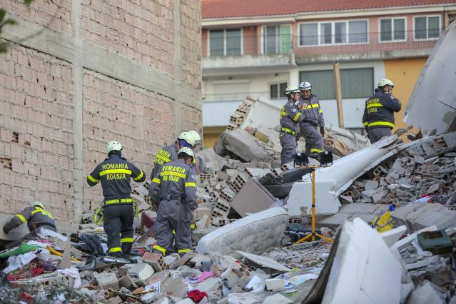 Rescuers search a damaged building in Albania, as the death toll rose to at least 24 overnight (AP)