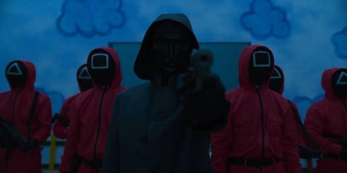 Several masked men standing with their guns