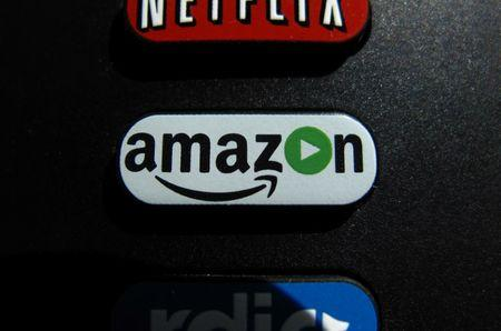 FILE PHOTO -  The Amazon TV button on a remote control is shown in this photo illustration