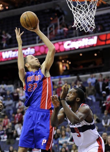 Detroit Pistons forward Tayshaun Prince (22) goes to the basket against Washington Wizards forward Martell Webster (9) during the first half of an NBA basketball game, Saturday, Dec. 22, 2012, in Washington. (AP Photo/Nick Wass)