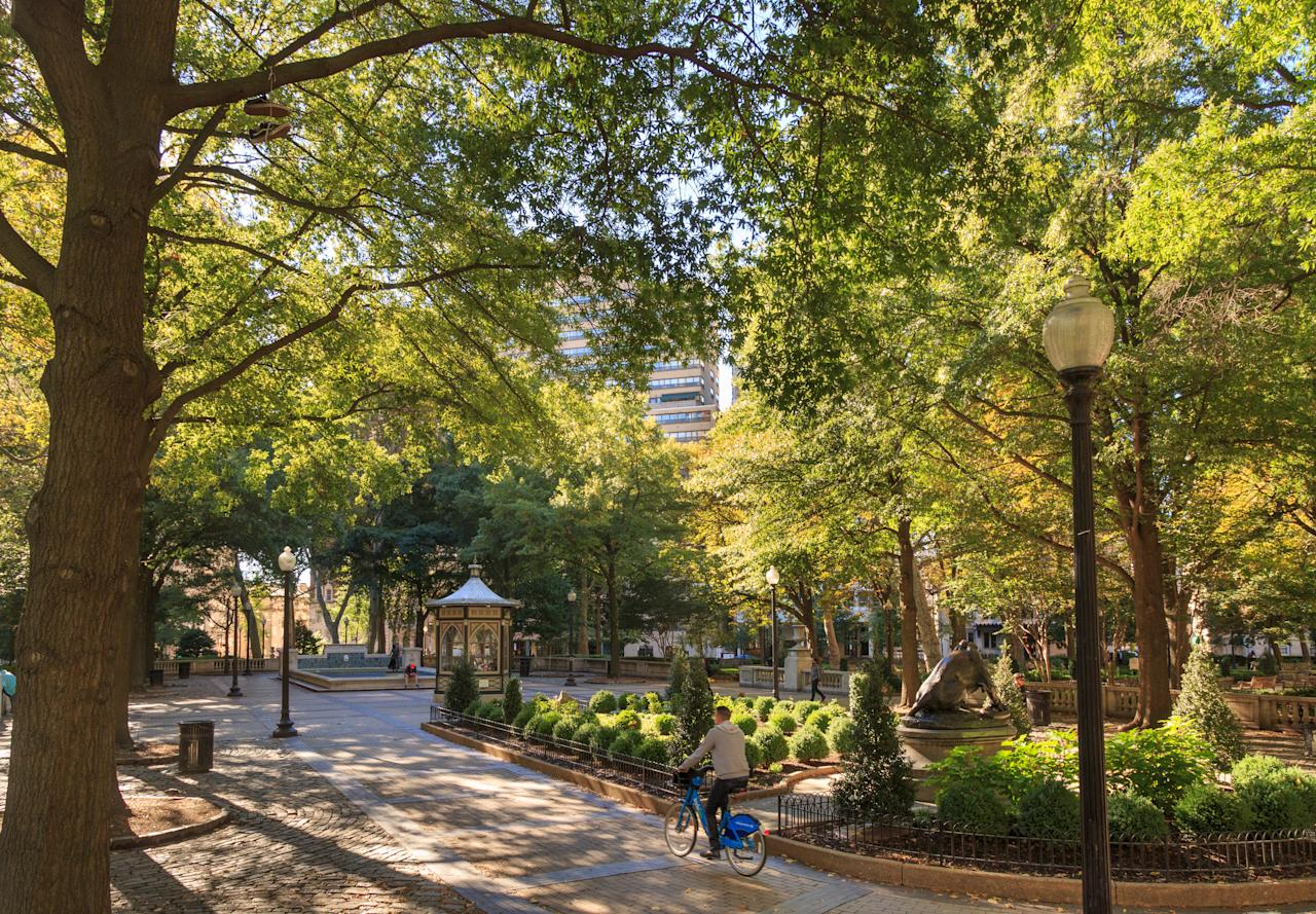 """<p><strong>Tell me: What's this place all about?</strong><br> When William Penn (the man Pennsylvania is named for and the chap atop City Hall) planned Philadelphia, he designed five squares that function as parks. Rittenhouse, the most glamorous of them all, is both a park and a catchall name for the surrounding neighborhood, which is home to some of the city's <a href=""""https://www.cntraveler.com/gallery/best-restaurants-in-philadelphia?mbid=synd_yahoo_rss"""">best restaurants</a>, shopping, and real estate.</p> <p><strong>What's it like being there?</strong><br> The square itself is a beautifully designed, well maintained park. In summer, a fountain in the center functions as a gathering space. If the weather's nice, pick up picnic supplies at Di Bruno Bros. Rittenhouse and find a seat on one of the park's many benches. Don't be surprised if someone's taking <a href=""""https://www.cntraveler.com/story/how-to-plan-a-trip-around-someone-elses-wedding-women-who-travel-podcast?mbid=synd_yahoo_rss"""">wedding</a> photos nearby. If it's chilly out—or if you have money to burn—grab a meal at <a href=""""https://www.cntraveler.com/restaurants/philadelphia/philadelphia/parc?mbid=synd_yahoo_rss"""">Parc</a>, which overlooks the square. After, stretch your legs by walking along Walnut Street, which is lined with high-end national brands, and Sansom Street, home to more local options, including the beloved Joseph Fox Bookshop.</p> <p><strong>How easy is it to navigate?</strong><br> In addition to outlining the five squares, William Penn set up Philadelphia on a grid, so navigation here (and almost anywhere in town) is simple for those who like to walk. Uber, taxis, and buses are also widely available in this section of the city, but be forewarned about traffic.</p>"""