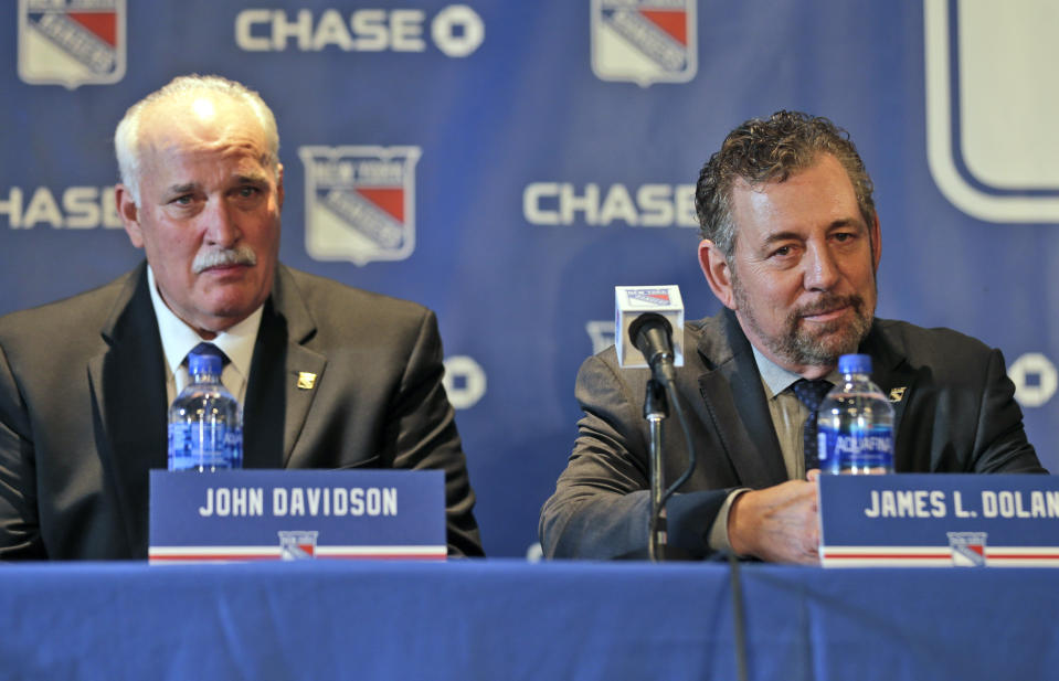 John Davidson, left, and James Dolan, owner of the New York Rangers, participate in a news conference in New York, Wednesday, May 22, 2019. Davidson was hired as team president Friday, hours after leaving his post with the Columbus Blue Jackets. He returns to New York where he spent parts of eight seasons as a Rangers goaltender and was a TV analyst for almost a decade. (AP Photo/Seth Wenig)