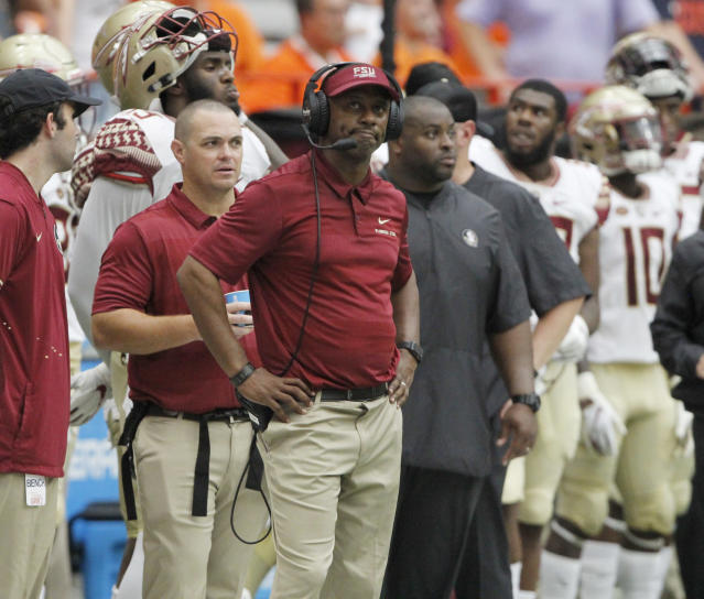 Florida State coach Willie Taggart looks at the scoreboard during his team's 30-7 loss to Syracuse. (AP)