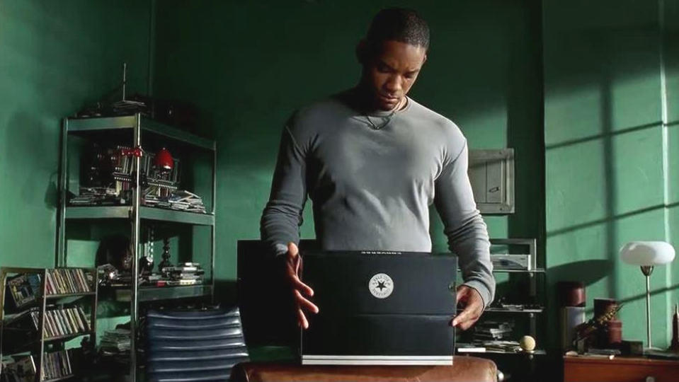 Will Smith unboxes a fresh pair of Converse in 'I, Robot'. (Credit: Fox)