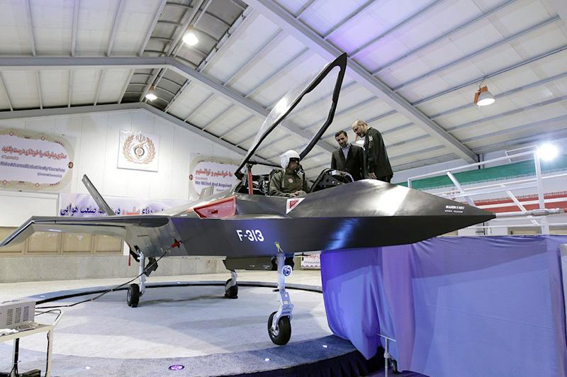 An unveiling ceremony for Iran's domestically designed and built Qaher (Conqueror) F-313 fighter aircraft in Tehran on February 2, 2013
