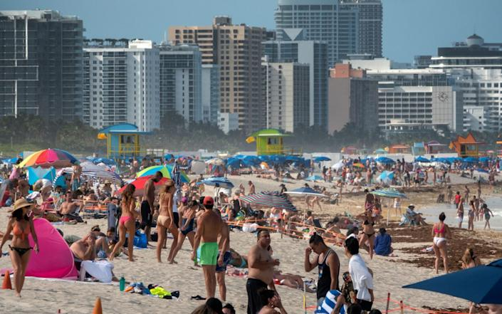 Hundred of people enjoy a warm day at the beach in Miami Beach - CRISTOBAL HERRERA/EPA-EFE/Shutterstock