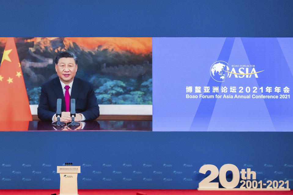 In this photo released by Xinhua News Agency, Chinese President Xi Jinping delivers a keynote speech via video for the opening ceremony of the Boao Forum for Asia (BFA) Annual Conference held in Boao in south China's Hainan Province, Tuesday, April 20, 2021. Xi on Tuesday called for more equitable management of global affairs and, in an implicit rejection of U.S. dominance, said governments shouldn't be allowed to impose rules on others. (Li Tao/Xinhua via AP)