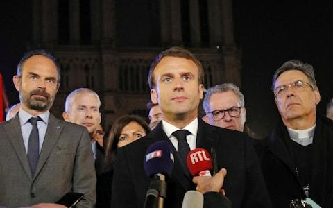 Emmanuel Macron was targeted by conspiracy theorists following the blaze - Credit: Philippe Wojazer/Reuters