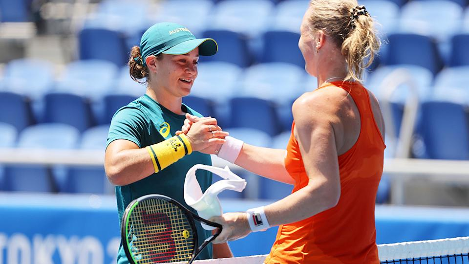 Ash Barty and Kiki Bertens, pictured here sharing a practice at the Tokyo Olympics.