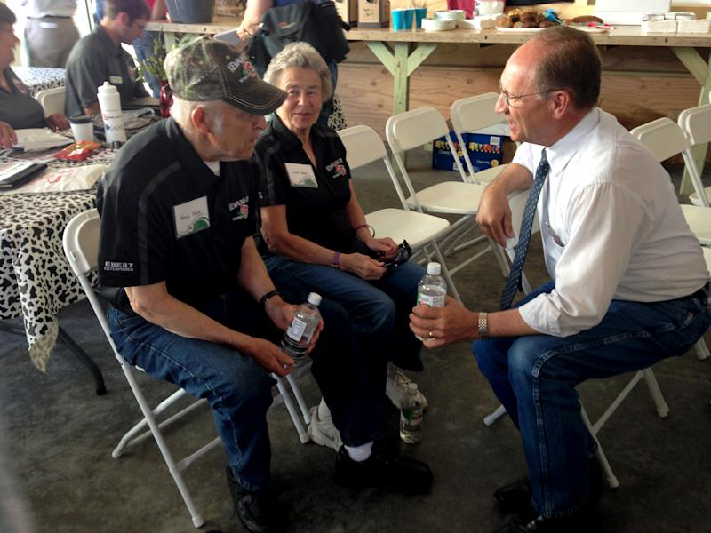 Then-Wisconsin Agriculture Secretary Ben Brancel meets with Henry and Carol Ebert during Farm Technology Days in Algoma, Wisconsin, June 6, 2017. Brancel, who retired in August, says the United States should change immigration law to accommodate the growing number of immigrants working in the dairy industry. (Dept of Agriculture Trade and Consumer Protection)