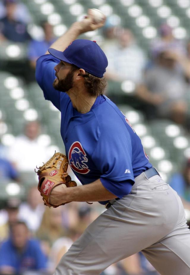Chicago Cubs starter Jake Arrieta pitches to the Milwaukee Brewers during the first inning of a baseball game Thursday, Sept. 19, 2013, in Milwaukee. (AP Photo/Darren Hauck)